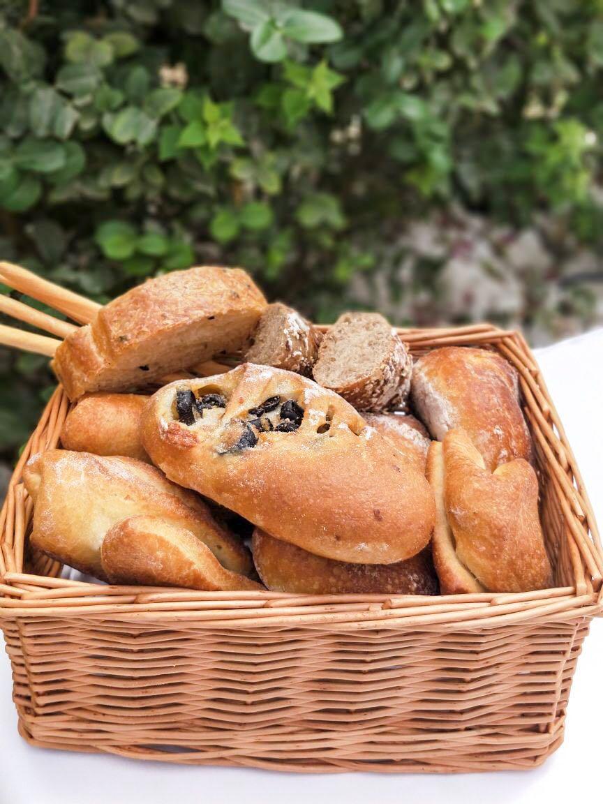 assorted bread, italian bread, french wine, casa mia, le meridian dubai